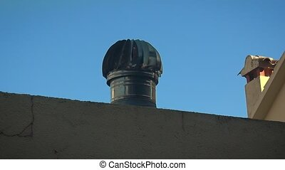 Spinning air ventilator on a roof - Spinning metal air...