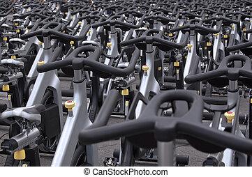 Spinning bikes - Large group of aluminum spinning bikes...