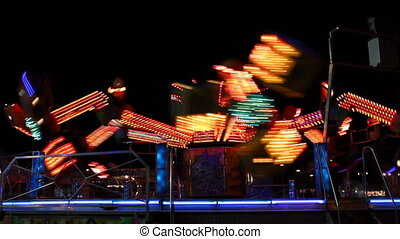 Spinning carousel in night