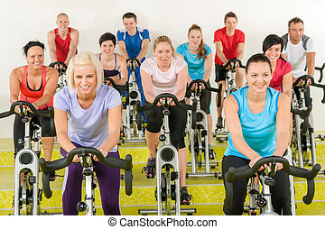 Spinning class at the gym - Spinning class group of young...