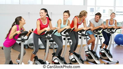 Spinning class in fitness studio