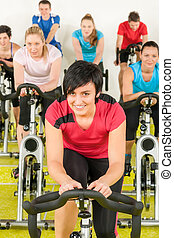 Spinning class sport people exercise at gym