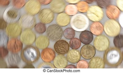 spinning coins - great number of coins symbolizing wealth,...