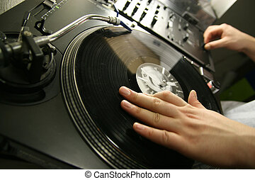 spinning disc - scratch battle of dj playing on his vinyls...