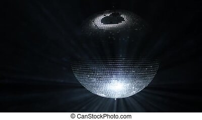 Spinning disco ball on a black background