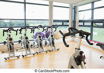 Spinning exercise bikes in gym room - Spinning exercise...
