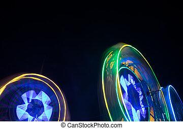 Spinning ferris wheel at night