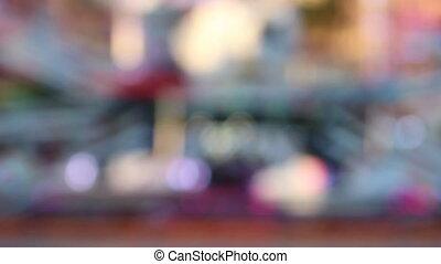 Spinning Illuminated Carousel Lights in Amusement Park -...