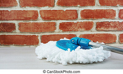 spinning mop with white microfiber on the floor
