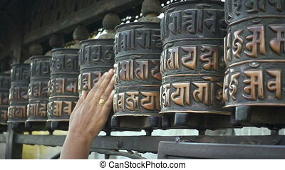 Spinning prayer wheels at the Swayambhunath Stupa,...