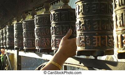 Spinning prayer wheels at the Swayambhunath Stupa,...