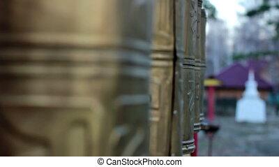 Spinning prayer wheels in a Buddhist monastery full d