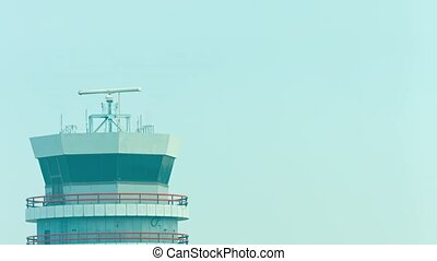 Spinning Radar Antenna atop an Air Traffic Control Tower -...