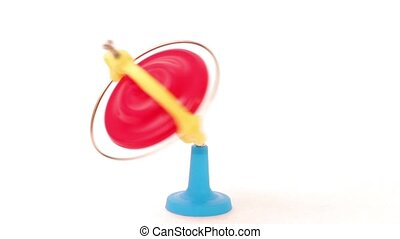 Spinning red, blue and yellow whirligig, children toy isolated