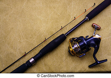 Spinning rod with fishing reel on the background of...
