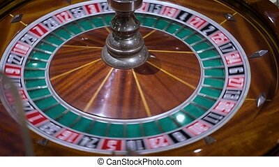 spinning roulette in the casino - Roulette table and...