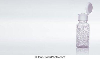 Transparent sanitize gel spinning on the presentation backround