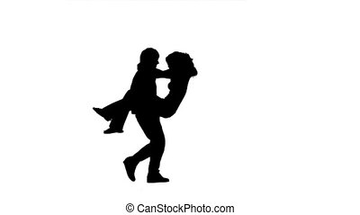 Spinning silhouettes of a couple in slow motion