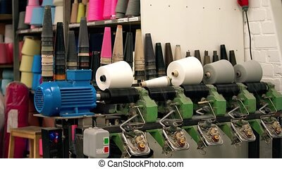 Spinning thread coils on textile manufacture