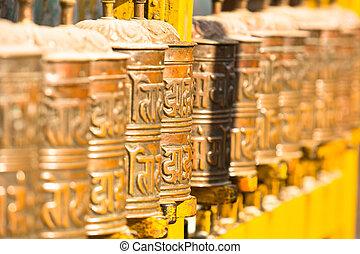 Spinning Tibetan Buddhist prayer wheels at Boudhanath stupa...