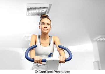Spinning, training on a stationary bicycle. Fitness club.