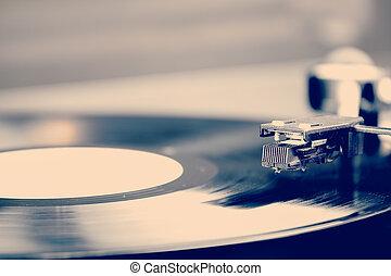 Spinning vinyl record. Motion blur image. Vintage toned....