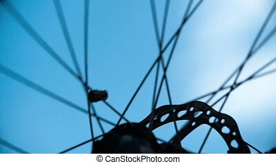 Spinning Wheel - Extreme close up of bicycle wheel spinning,...