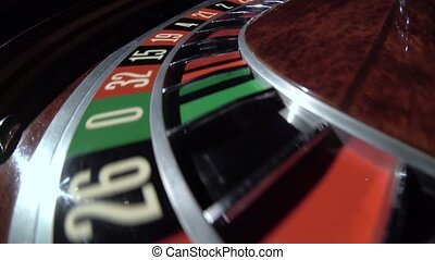 Spinning wheel with ball at number 16 in the roulette game. Number 16 red. Close up
