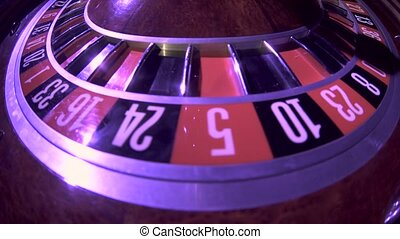 Spinning wheel with ball at zero in the roulette game. Close up
