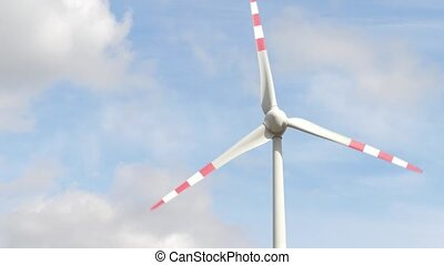 Spinning wind generator against clouds and sky - Wind...