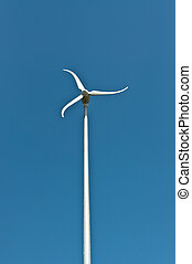 Spinning Windmill with Blue Sky