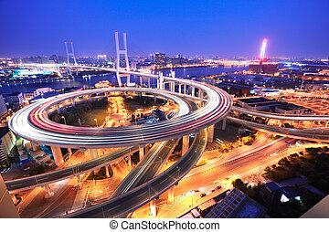 Spiral bridge in Shanghai Huangpu River on the bird's eye...