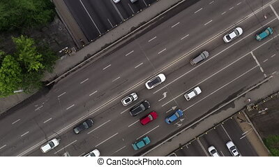 Spiral Helix Shot of a road junction with the intersection of motorways. Multi-lane traffic on highways in the city. Drone Shot.