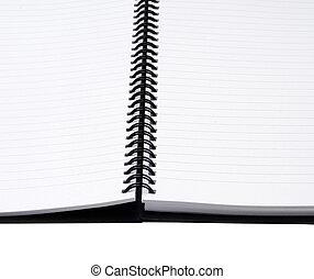 spiral notebook on white