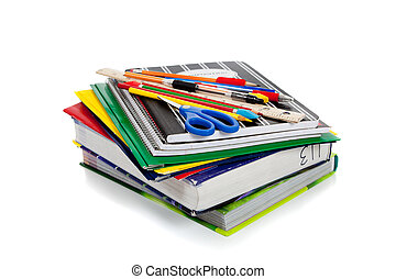 Spiral notebooks with school supplies on top
