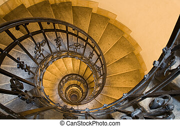 Spiral staircase and stone steps in ancient tower - Spiral...