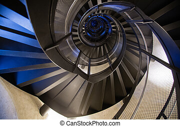 Spiral staircase bottom view. Geometric background