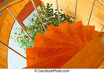 Spiral staircase in the modern wooden house.