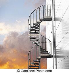 Spiral staircase on orange sky