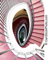 spiral staircase, red carpet