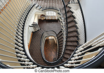 Spiral staircase with black railing - Spiral staircase in...
