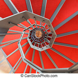 spiral staircase with red carpet in a building