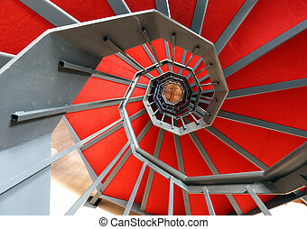spiral staircase with red carpet in a modern building