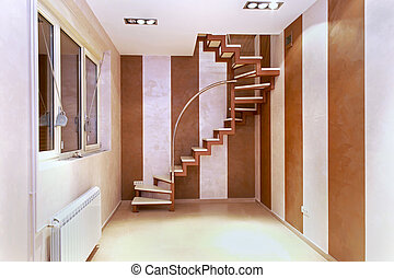 Spiral stairs inside corner of small modern room interior