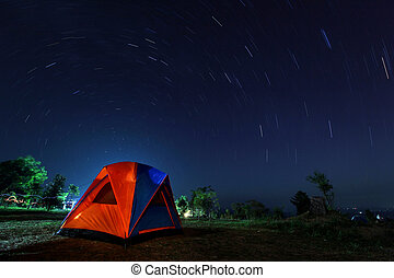 spiral star trail with campsite at night