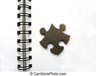 Spirale and jigsaw - Metallic jigsaw piece on an office...