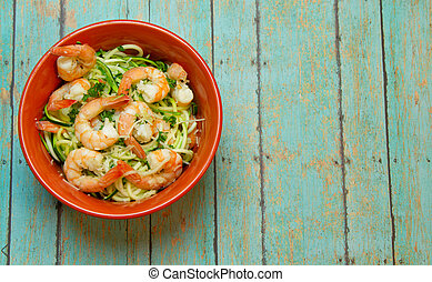 Spiralized Zucchini with jumbo shrimp on wood board - Bowl ...