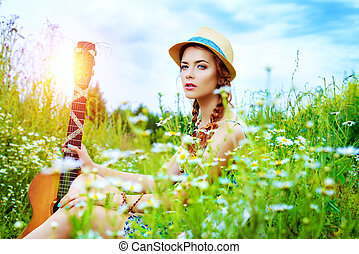 spirit of freedom - Beautiful romantic girl with a guitar on...