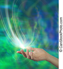 Female open hand with a white energy formation floating above on an ethereal green and blue background and plenty of copy space