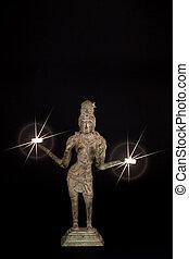 Spiritual enlightenment. Hindu Goddess Lakshmi with divine light from candles.